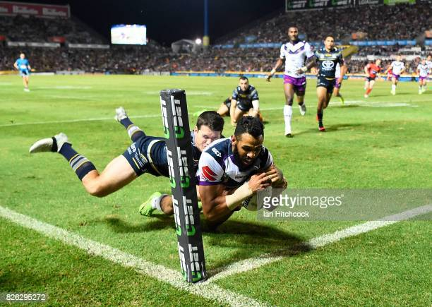 Joshua AddoCarr of the Storm scores a try during the round 22 NRL match between the North Queensland Cowboys and the Melbourne Storm at 1300SMILES...