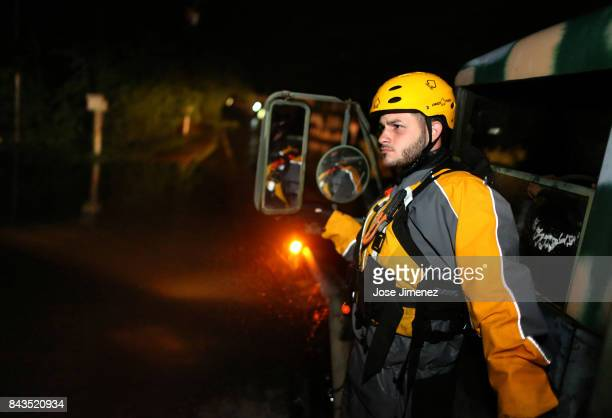 Joshua Alicea a member of a rescue team from the local emergency management agency inspects flooded areas after the passing of Hurricane Irma on...