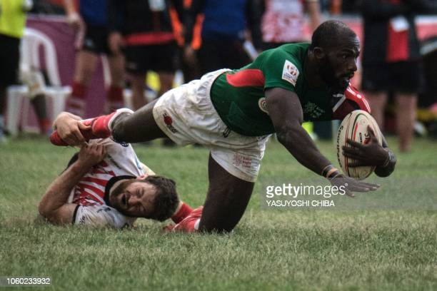 Joshua Bassingthwaighte of Samurai RFC tackles Dennis Ombachi of Kenya's national team Shujaa during the final of Safari Sevens Kenya's annual rugby...
