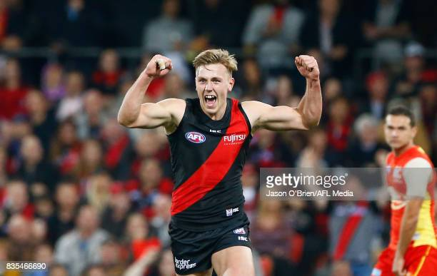 Joshua Begley of the Bombers celebrates kicking a goal during the round 22 AFL match between the Gold Coast Suns and the Essendon Bombers at Metricon...