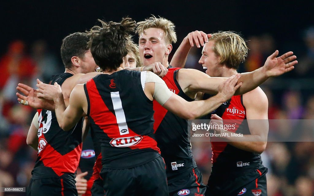 Joshua Begley of the Bombers celebrates kicking a goal during the round 22 AFL match between the Gold Coast Suns and the Essendon Bombers at Metricon Stadium on August 19, 2017 in Gold Coast, Australia.