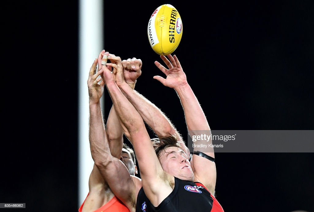 Joshua Begley of the Bombers competes for the ball during the round 22 AFL match between the Gold Coast Suns and the Essendon Bombers at Metricon Stadium on August 19, 2017 in Gold Coast, Australia.