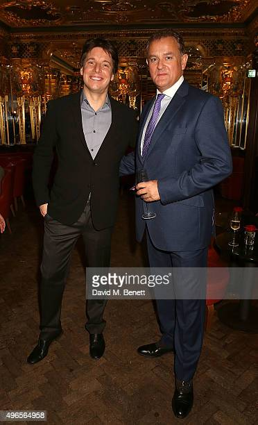 Joshua Bell and Hugh Bonneville attend A Musical Soiree The Academy Of St Martin In The Fields at Hotel Cafe Royal on November 10 2015 in London...