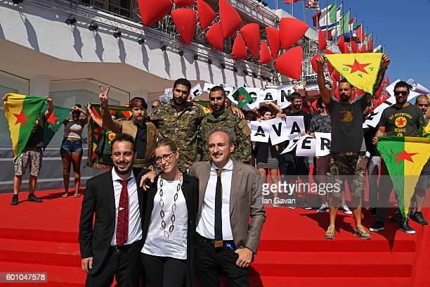 Joshua Bell Karim Franceschi Rafael Kardari Bruno Chiaravalloti Benedetta Argentieri and Claudio Jampaglia pose with protesters for the Kurdish...