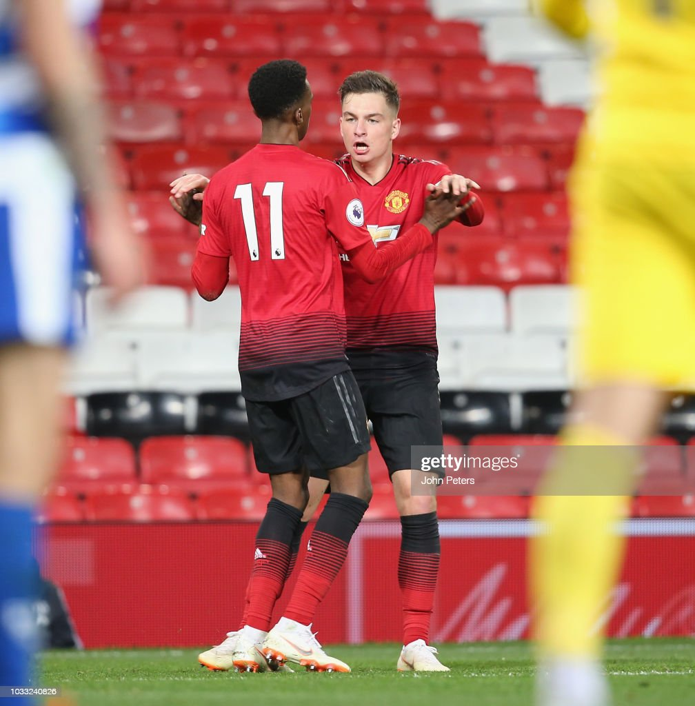 Joshua Bohui (L) of Manchester United U23s celebrates scoring their first goal during the Premier League 2 match between Manchester United U23s and Reading U23s at Old Trafford on September 14, 2018 in Manchester, England.