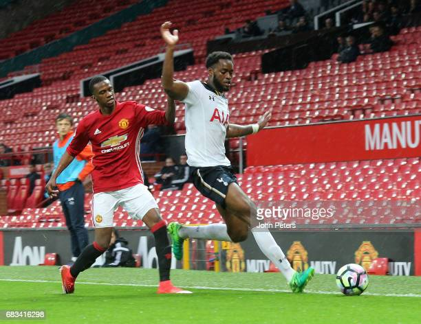 Joshua Bohui of Manchester United U23s in action with Christian Maghoma of Tottenham Hotspur during the Premier League 2 match between Manchester...