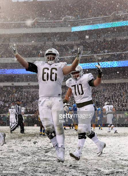 Joshua Boylan and Mike Houghton of the Army Black Knights celebrate a touchdown in the first half against the Navy Midshipmen on December 9 2017 at...