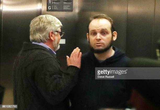MISSISSAUGA ON OCTOBER 13 Joshua Boyle gets a pat on the shoulder from his father Patrick Boyle after speaking to media He and his wife Caitlain...