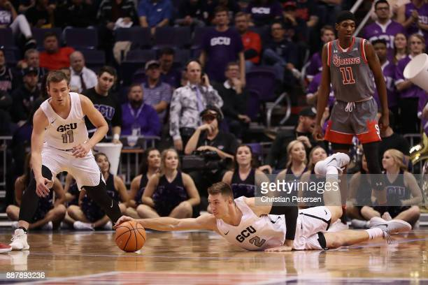 Joshua Braun of the Grand Canyon Antelopes dives for the ball during the first half of the college basketball game against the St John's Red Storm at...