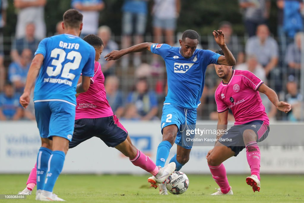 Joshua Brenet of Hoffenheim competes for the ball against Jordan Cousins during the pre-season friendly match between Queens Park Rangers and TSG 1899 Hoffenheim on July 21, 2018 in Eppingen, Germany.