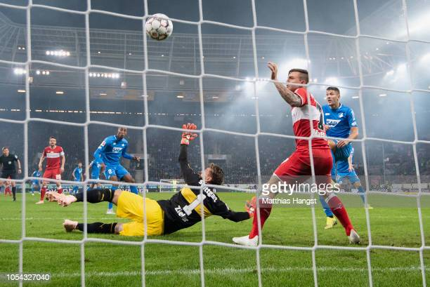 Joshua Brenet of Hoffenheim scores his team's first goal past Goalkeeper RonRobert Zieler of Stuttgart during the Bundesliga match between TSG 1899...