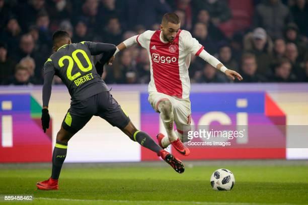 Joshua Brenet of PSV Hakim Ziyech of Ajax during the Dutch Eredivisie match between Ajax v PSV at the Johan Cruijff Arena on December 10 2017 in...