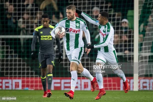 Joshua Brenet of PSV Lars Veldwijk of FC Groningen Juninho Bacuna of FC Groningen during the Dutch Eredivisie match between FC Groningen and PSV...