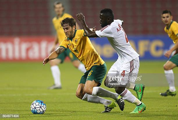 Joshua Brillante of Australia and Ahmed Barman of the United Arab Emirates battle for the ball during the AFC U23 Championship Group D match between...