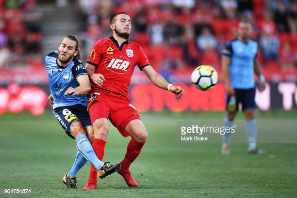 Joshua Brillante of Sydney FC gets the kick away from Apostolos Stamatelopoulos of Adelaide United during the round 16 ALeague match between Adelaide...