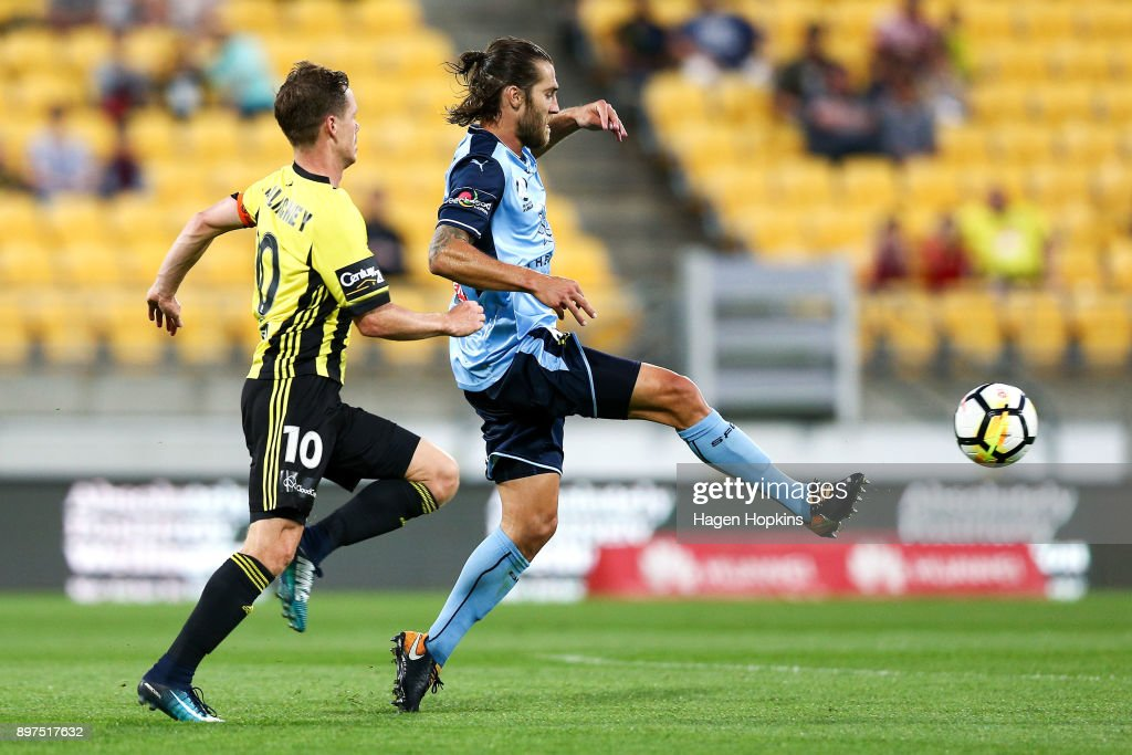 Joshua Brillante of Sydney FC passes under pressure from Michael McGlinchey of the Phoenix during the round 12 A-League match between the Wellington Phoenix and Sydney FC at Westpac Stadium on December 23, 2017 in Wellington, New Zealand.