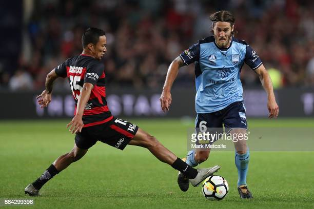 Joshua Brilliante of Sydney FC takes on Kearyn Baccus of the Wanderers during the round three ALeague match between Sydney FC and the Western Sydney...