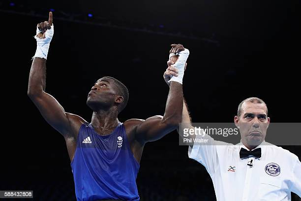 Joshua Buatsi of Great Britain celewbrates winning over Eishoot Rasulov of Uzbekistan in their Mens Light Heavyweight bout on Day 6 of the 2016 Rio...