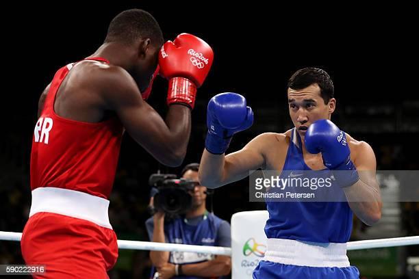 Joshua Buatsi of Great Britain fights against Adilbek Niyazymbetov of Kazakhstan during the Men's Light Heavy Semifinal 2 on Day 11 of the Rio 2016...