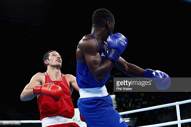 Joshua Buatsi of Great Britain knocks out Eishoot Rasulov of Uzbekistan in their Mens Light Heavyweight bout on Day 6 of the 2016 Rio Olympics at...