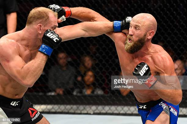 Joshua Burkman punches Zak Ottow in their welterweight bout during the UFC Fight Night event at the Moda Center on October 1 2016 in Portland Oregon