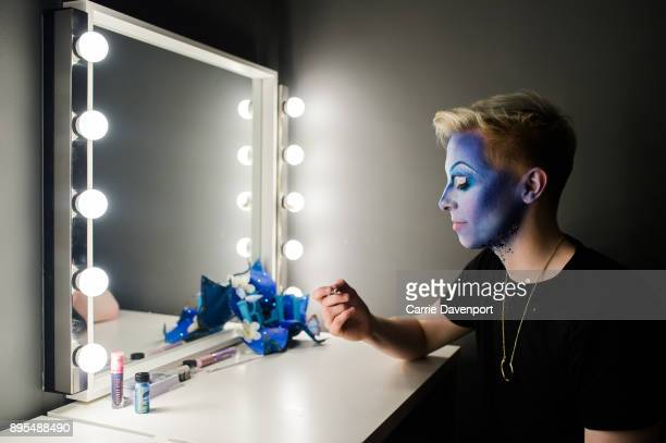 Joshua Cargill aka Blu Hydrangea is photographed getting into drag backstage as part 'Visage' a collaborative exhibition with designer Aaron Eakin...