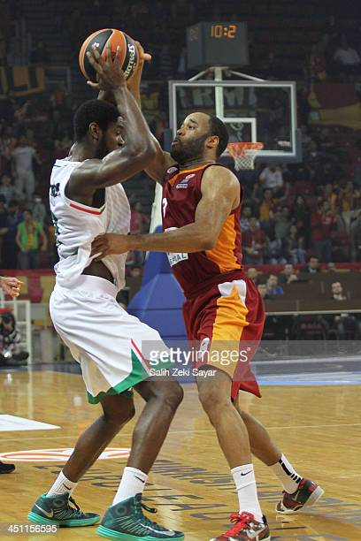 Joshua Carter of Montepaschi Siena competes with Malik Hairston of Galatasaray Liv Hospital during the 20132014 Turkish Airlines Euroleague Regular...