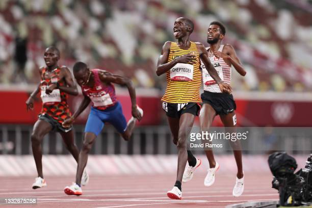 Joshua Cheptegei of Team Uganda reacts as he wins the gold medal in the Men's 5000m Final on day fourteen of the Tokyo 2020 Olympic Games at Olympic...