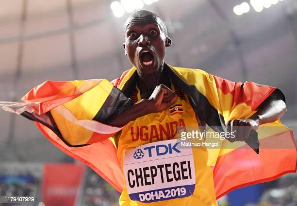 Joshua Cheptegei of Uganda celebrates winning gold in the Men's 10,000 metres final during day ten of 17th IAAF World Athletics Championships Doha...