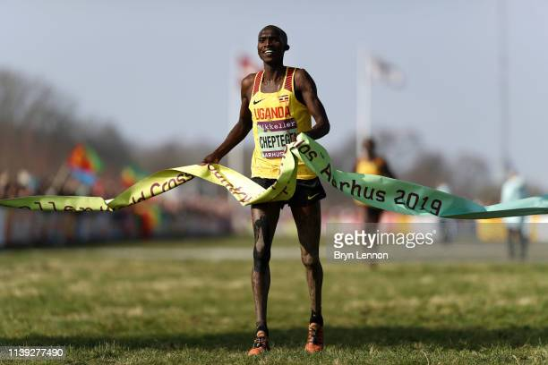 Joshua Cheptegei of Uganda crosses the line to win the Men's Senior Final during the IAAF World Athletics Cross Country Championships on March 30...