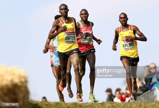 Joshua Cheptegei of Uganda Geoffrey Kamworor of Kenya and Jacob Kiplimo of Uganda compete in the Senior Men's Final during the IAAF World Athletics...