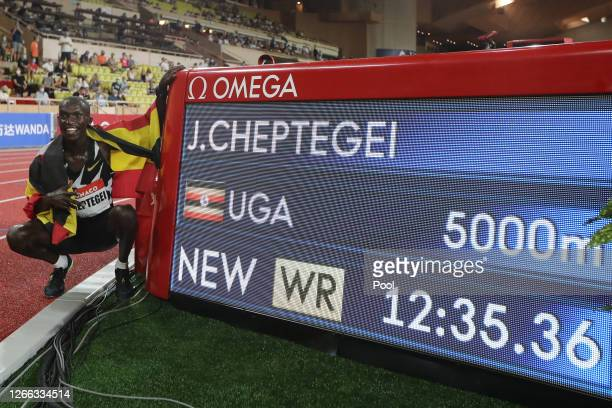 Joshua Cheptegei of Uganda poses for a photo next to a timing board displaying the new world record during the Herculis EBS Monaco 2020 Diamond...