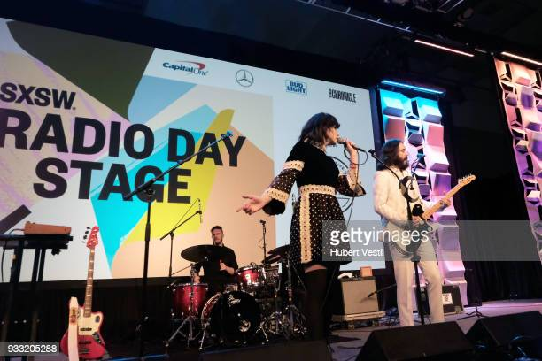 Joshua Clair Angela Gail Mattson and Jeffrey Jacob Mendel of In The Valley Below perform onstage at 101x during SXSW at Radio Day Stage on March 17...