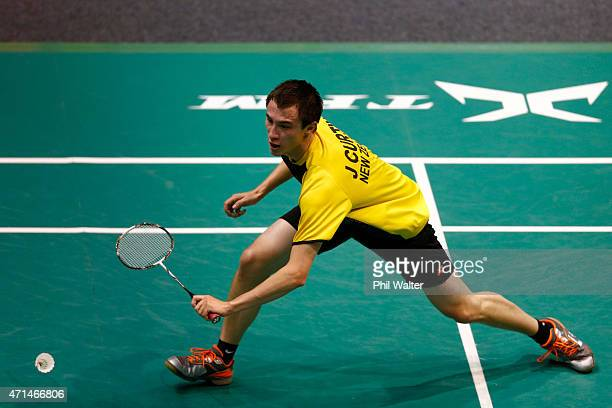 Joshua Curry of New Zealand plays a return against Anand Pawar of Indonesia during the 2015 Badminton Open at the North Shore Events Centre on April...
