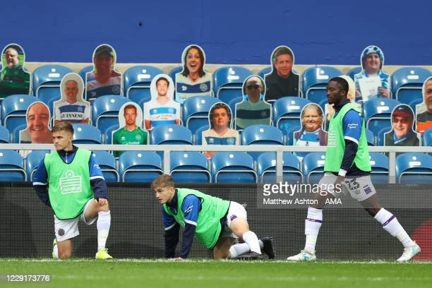 Joshua Daniels Scott High and Daniel Udoh of Shrewsbury Town warm up in front of cut out QPR fans during the Sky Bet League One match between AFC...