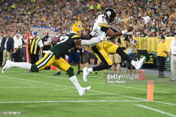 Joshua Dobbs of the Pittsburgh Steelers avoids a tackle by Josh Jones of the Green Bay Packers to score a two point conversion during the third...