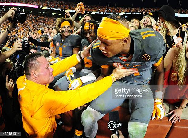 Joshua Dobbs of the Tennessee Volunteers is congratulated by Head Coach Butch Jones after the game against the Georgia Bulldogs on October 10 2015 at...