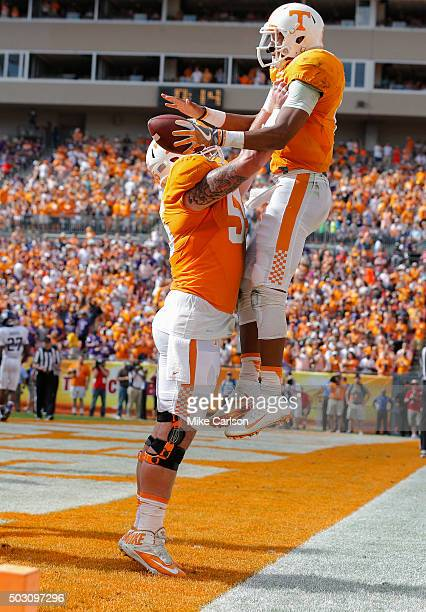 Joshua Dobbs of the Tennessee Volunteers is lifted by Coleman Thomas after scoring a touchdown against the Northwestern Wildcats during the first...