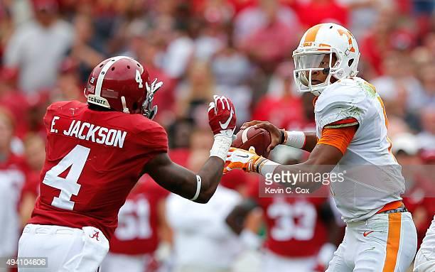 Joshua Dobbs of the Tennessee Volunteers is pressured by Eddie Jackson of the Alabama Crimson Tide at BryantDenny Stadium on October 24 2015 in...