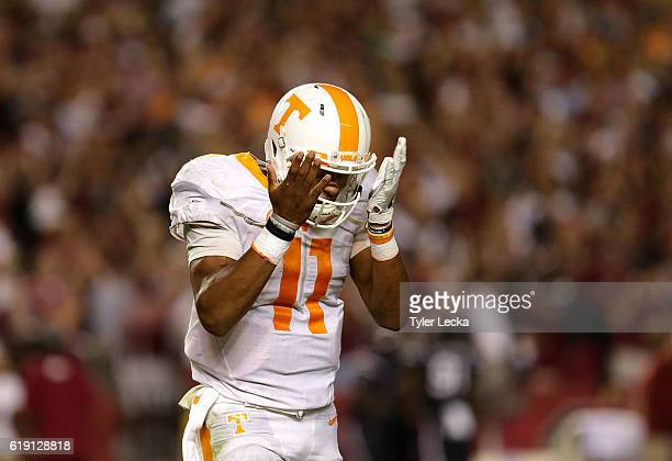 Joshua Dobbs of the Tennessee Volunteers reacts after throwing an interception in the fourth quarter against the South Carolina Gamecocks during...
