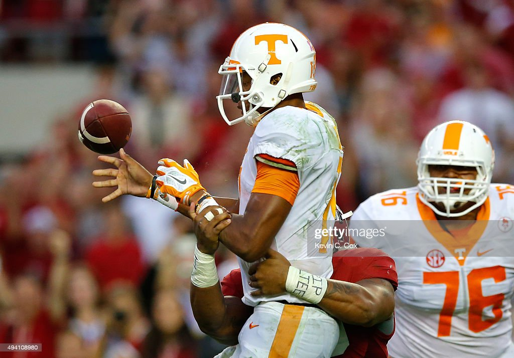 Joshua Dobbs #11 of the Tennessee Volunteers turns the ball over as he fumbles off a tackle by Ryan Anderson #22 of the Alabama Crimson Tide in the final seconds of their 19-14 loss at Bryant-Denny Stadium on October 24, 2015 in Tuscaloosa, Alabama.