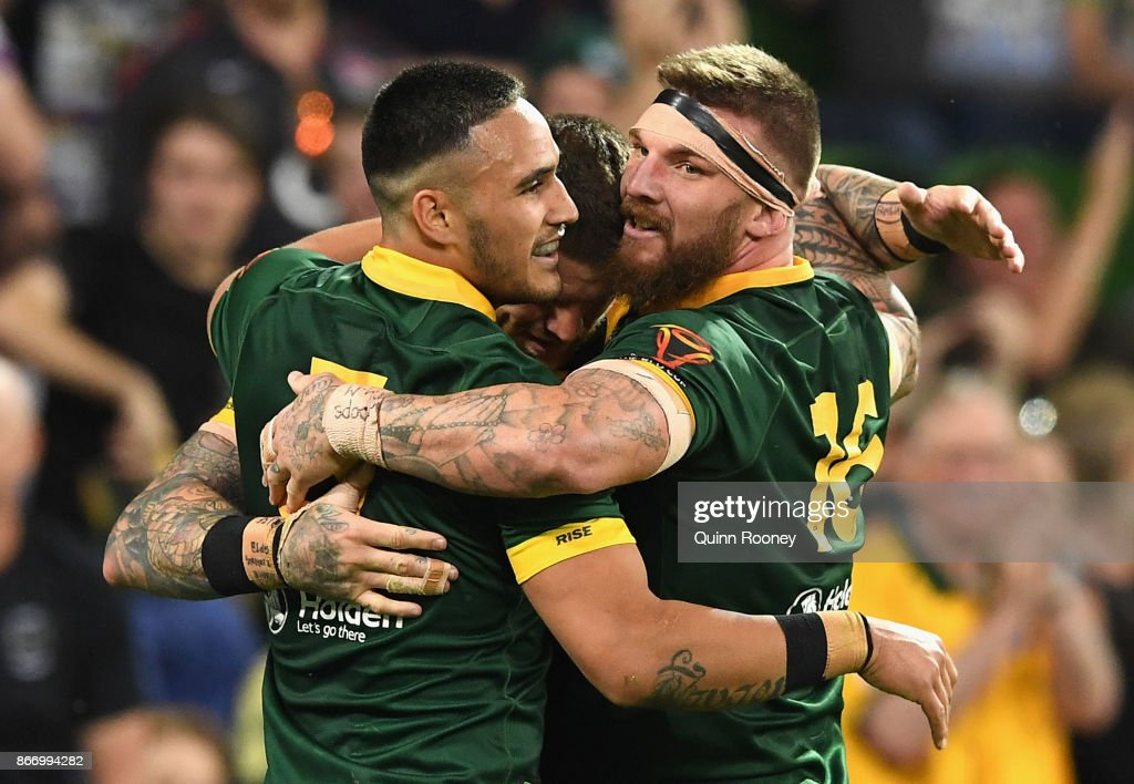 Joshua Dugan of Australia is congratulated by Valentine Holmes and Joshua McGuire after scoring a try during the 2017 Rugby League World Cup match between the Australian Kangaroos and England at AAMI Park on October 27, 2017 in Melbourne, Australia.