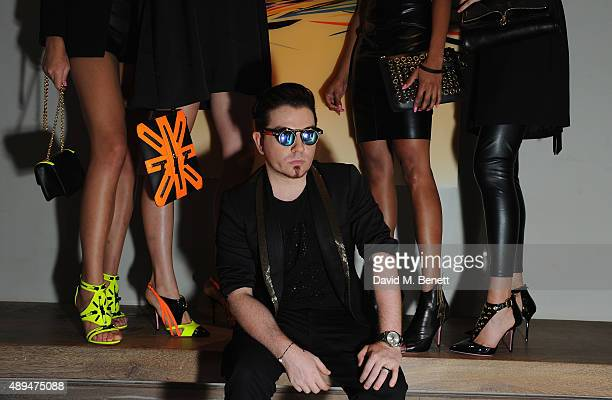 Joshua Fenu poses with models at the JF London Shoe Launch party at Haymarket Hotel on September 21 2015 in London England Photo by David M Benett/