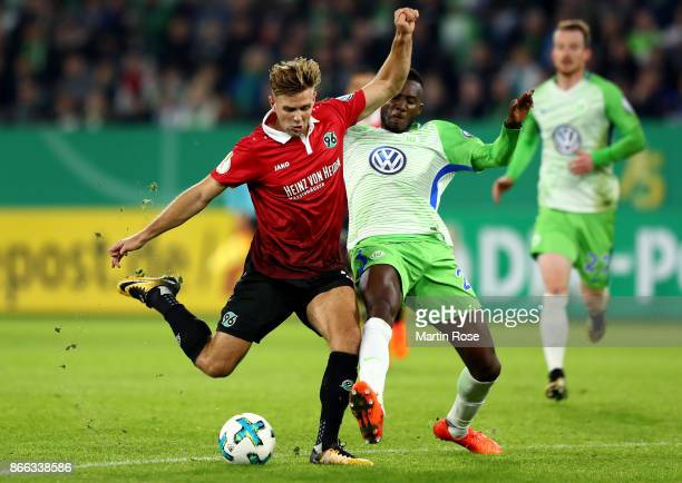 Joshua Guilavogui of Wolfsburg and Niclas Fuellkrug of Hannover battle for the ball during the DFB Cup match between VfL Wolfsburg and Hannover 96 at...