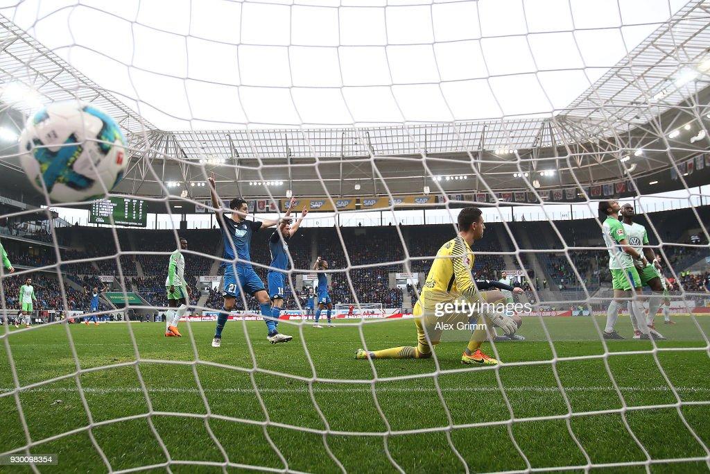 Joshua Guilavogui of Wolfsburg (r) scores and own goal to make it 3:0 during the Bundesliga match between TSG 1899 Hoffenheim and VfL Wolfsburg at Wirsol Rhein-Neckar-Arena on March 10, 2018 in Sinsheim, Germany.