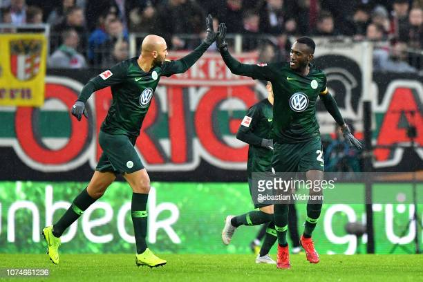 Joshua Guilavogui of Wolsfburg celebrates with John Anthony Brooks of VfL Wolfsburg after he scores his sides first goal during the Bundesliga match...