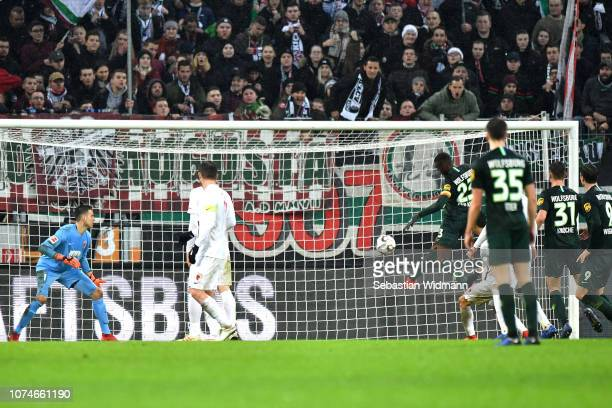 Joshua Guilavogui of Wolsfburg scores his sides first goal during the Bundesliga match between FC Augsburg and VfL Wolfsburg at WWK-Arena on December...