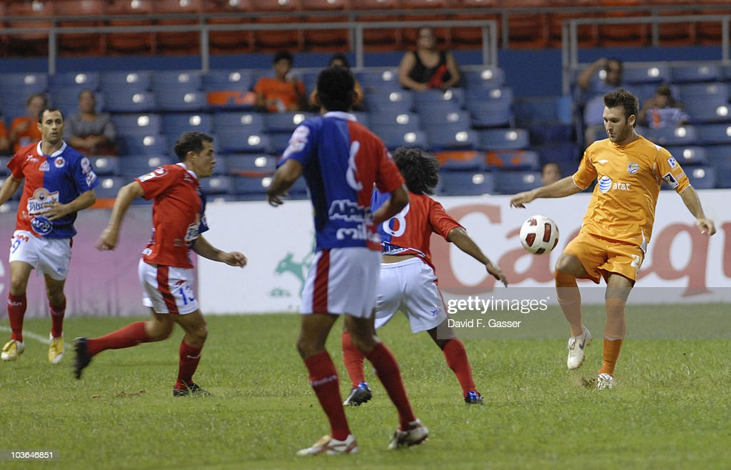 Joshua Hansen (R) of Islanders vies the ball with player of FAS during their match as part of 2010 CONCACAg Champions League at Juan Ramon Loubriel Stadium on August 25, 2010 in Baymon, Puerto Rico.