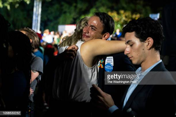 Joshua Hansen wipes away tears and hugs others as Tallahassee Mayor and Democratic nominee for Governor of Florida Andrew Gillum speaks as he...