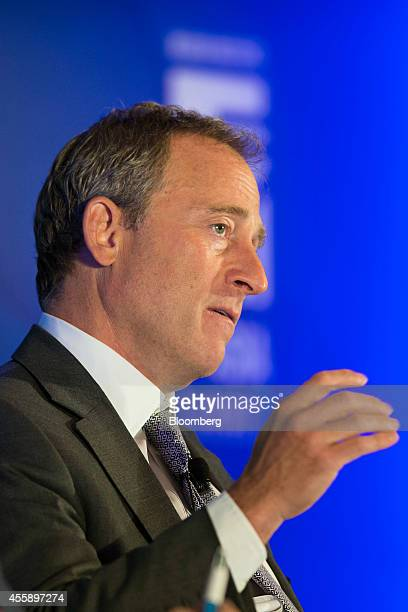 Joshua Harris cofounder of Apollo Global Management LLC gestures as he speaks at the Milken Institute Asia Summit in Singapore on Friday Sept 19 2014...